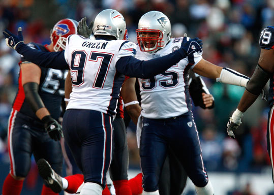 Patriots linebacker Tully Banta-Cain (No. 95) and defensive end Jarvis Green (No. 97) celebrate a sack.