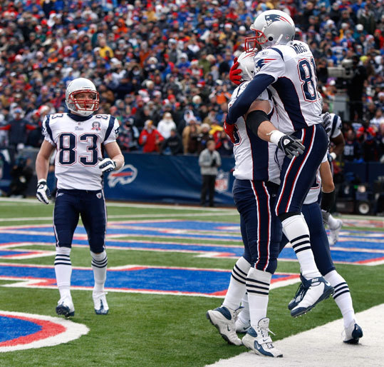 Patriots wide receiver Randy Moss (No. 81) celebrates his second quarter touchdown reception.