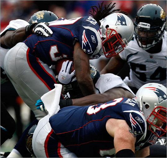 Patriots running back Laurence Maroney (left) made a costly error in the first quarter, fumbling the ball near the goal line and turning it over to Jacksonville.