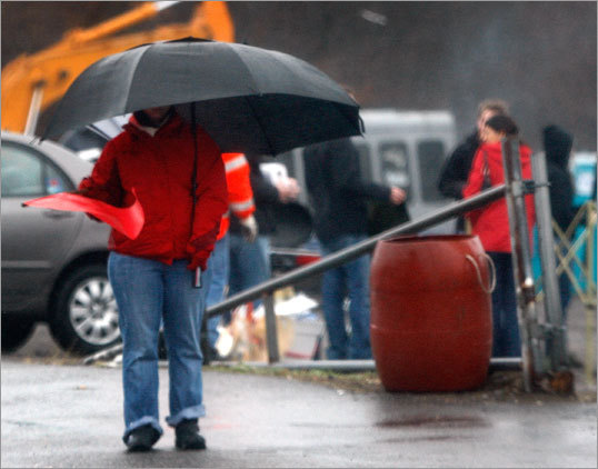 A parking attendant tried to stay dry before Sunday's game.