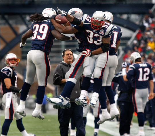 Patriots head coach Bill Belichick has a good view as his players celebrate a touchdown in the first half. The Patriots defeated the Jacksonville Jaguars, 35-7, and clinched the AFC East title with the win.