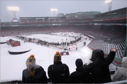 Some fans viewed the Bruins' practice from the seats atop Fenway Park's Green Monster.