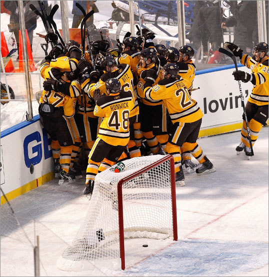 The Bruins celebrated after the game-winner, in overtime, gave them the victory over the Flyers.