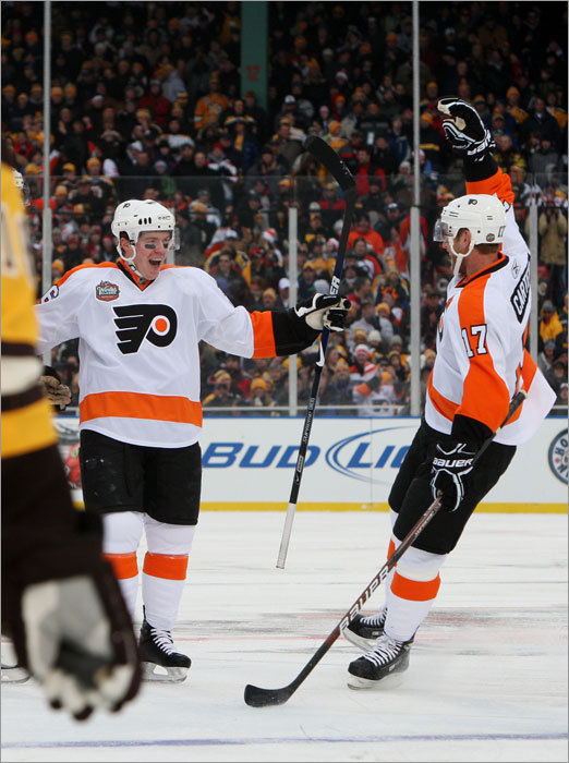 Danny Syvret (left) scored his first career NHL goal in the second period to give the Flyers a 1-0 lead. He celebrated with teammate Jeff Carter.