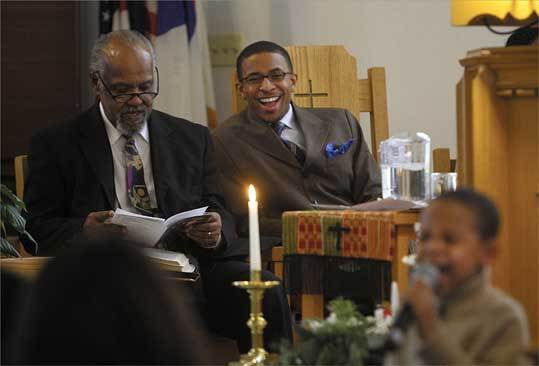 The Rev. Brandon T. Crowley (center) presides over a Sunday service at Newton's Myrtle Baptist Church, following Howard Haywood (left) as pastor.