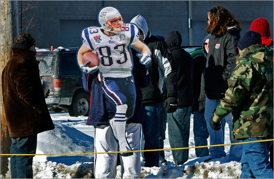Patriots wide receiver Wes Welker was not playing Sunday, but fans didn't forget about him. One carried a giant cutout of the injured Patriots star on their back.