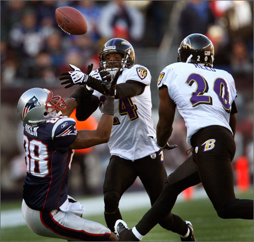 Ravens cornerback Domonique Foxworth (24) breaks up a pass intended for Sam Aiken (88). Ed Reed (20) came in and intercepted the ball, one of three interceptions Brady would finish with on the day.