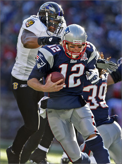 Tom Brady tried but couldn't beat linebacker Ray Lewis as he sacked the quarterback. Lewis had a dominating 13 tackles in the playoff game.