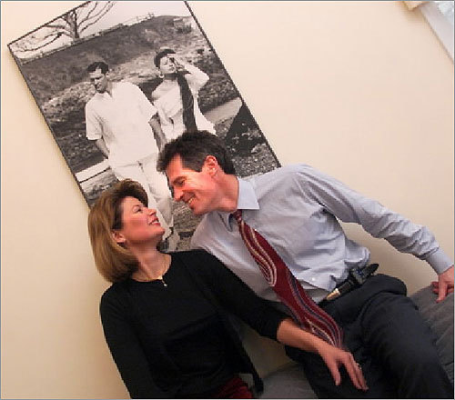 Both Brown and Huff worked as models in their younger days. In a 2001 Globe photo, the couple sat in front of a modeling shot in their home.