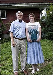 Black-I Robotics's Brian Hart and his wife, Alma, posed with a picture of their son John (left), who was killed in Iraq in 2003. Hart worked with Ted Kennedy to procure funds to better protect soldiers.