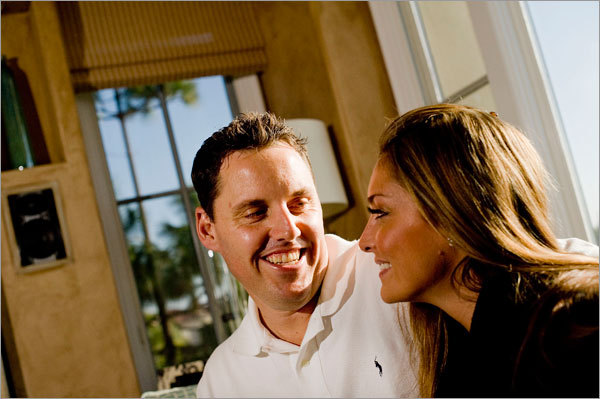 New Red Sox pitcher John Lackey and his wife Krista share a moment in the living room of their home in Newport Beach, Calif.