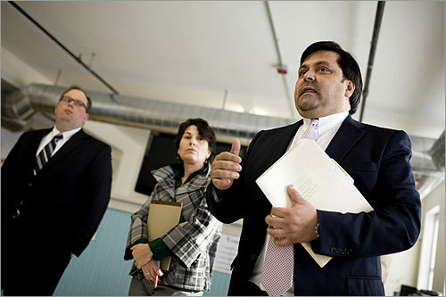 Carlos Escobedo spoke to a room of illegal immigrants with attorneys Deborah Gonzalez, left center, and Alex Isbell, left, at the Guatemalan Consulate in Providence, RI.