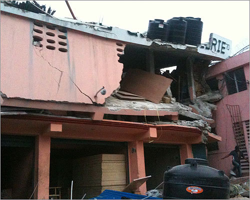 Another multi-story building badly damaged by the massive quake.