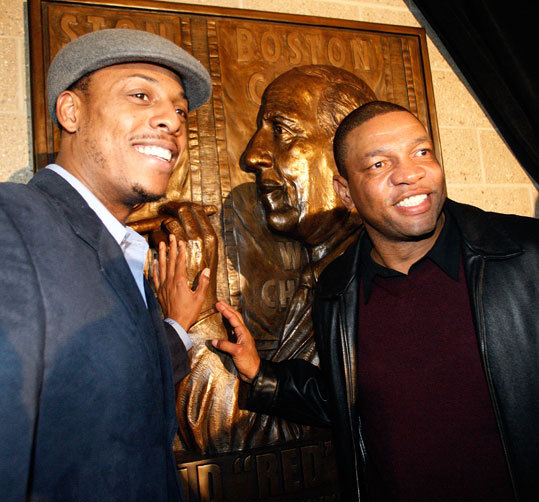 Celtics captain Paul Pierce (left) and coach Doc Rivers posed in front of the plaque at North Station depicting legendary Celtics coach Red Auerbach. The plaque was unveiled and the train station's concourse was dedicated Friday in honor of Auerbach, who passed away in 2006.