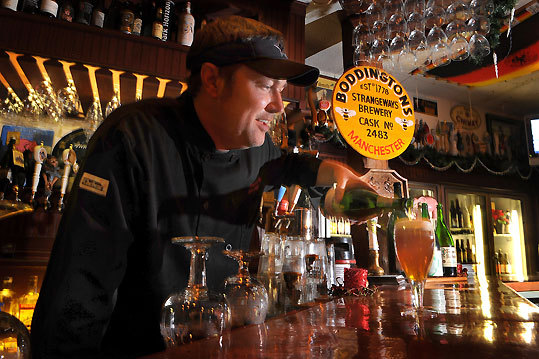 Chris Lively, owner, chef, and now a beer connoisseur, at Ebenezer's in Lovell, Maine.