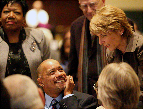 Coakley greeted Edward Mallory, of Dorchester, while State Representative Gloria Fox, left, of Roxbury, stood nearby.