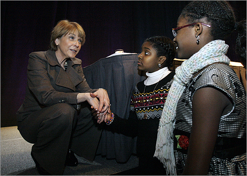 Coakley spoke with Morgan Nicholas, 10, and Christina Barnes, 11, of Boston, during the MLK breakfast.
