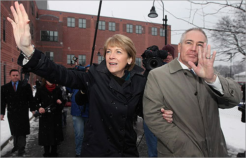 Coakley and her husband Thomas waved to supporters outside Brooks Elementary School.