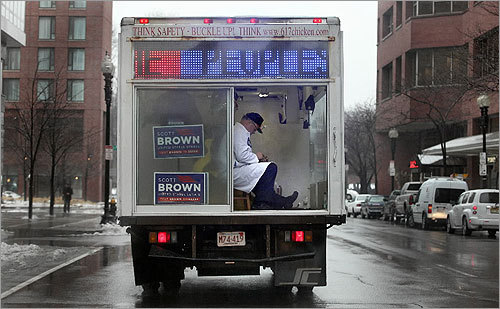 Chris Bock of Newton rode around Boston in his 'mobile office' -- a 14-foot glass-enclosed box truck -- to encourage people to vote for Brown. 'I'm doing this 'cause I want to see him win,' he said. 'I sit in that chair 'cause I'm on the watch.'