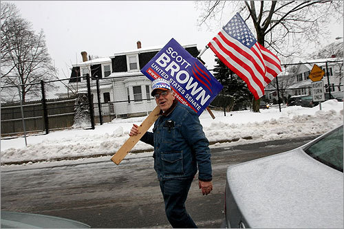 Brown supporter Richard Travers of Medford walked outside Brooks Elementary School.