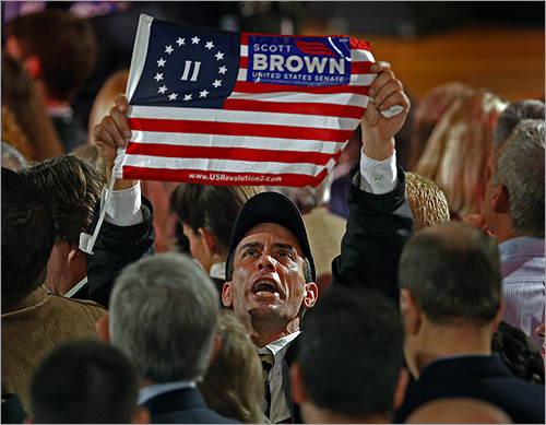 A Brown supporter yelled and waved a Brown flag at the Park Plaza Hotel.