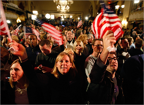 Barbarann O'Neil, center, of Wrentham and Jacob Porter, right, of Bucks County, Pa., waved flags in support of Brown.
