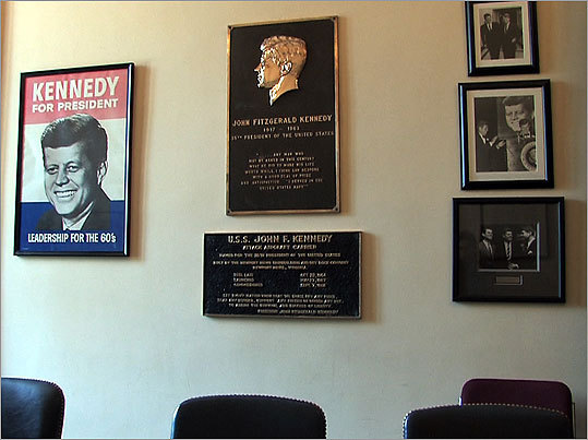 Plaques removed from the side of the decommissioned USS John F. Kennedy aircraft carrier were displayed in Kennedy's front office.