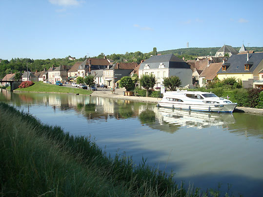 The canal boat, moored along the small waterfront of Menetreol-sous-Sancerre, a village near the hilltop town of Sancerre.