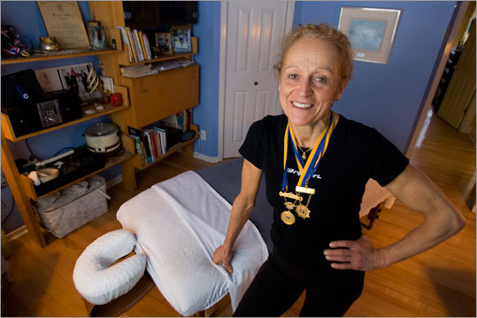Jacqueline Gareau, the 1980 Boston Marathon women's winner, and now a massage therapist, poses at home in Ste. Adele, Quebec. Gareau, who was robbed of glory by infamous cheater Rosie Ruiz who entered the race in the last mile, plans to run the 2010 Boston Marathon.