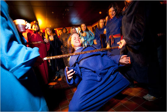 Kelsey Vale of Coventry, R.I., made it under the bar during Snuggie Limbo. She eventually won the contest.