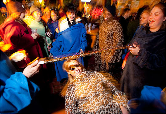 Samantha Gingras of Somerville took her turn at Snuggie Limbo at P.A.'s Lounge. . .