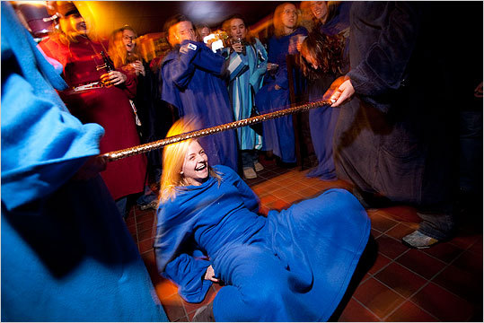 Juliana Tondorf of the North End failed to make it under the bar during Snuggie Limbo. She purchased the Snuggie just prior to the event. 'I'm more of a Slanket girl myself,' Tondorf said.