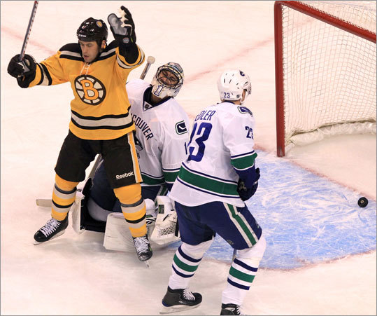 Boston left wing Marco Sturm (16) celebrated after the Boston Bruins scored their second goal in the first period against Vancouver Canucks goalie Roberto Luongo.