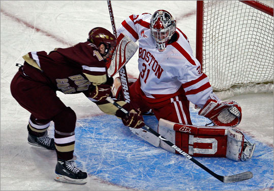 Boston College's Chris Kreider slipped the puck past Boston University goalie Kieran Millan in the second period to put the Eagles ahead 3-1 in the title game of the Beanpot tournament Monday at TD Garden.