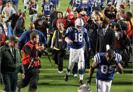 Super Bowl XLIV: Feb. 7, 2010 In a scene that probably brought joy to some Patriots fans, Manning walked off the field a 31-17 loser in Super Bowl XLIV. The loss dropped Manning's career playoff record to 9-9.