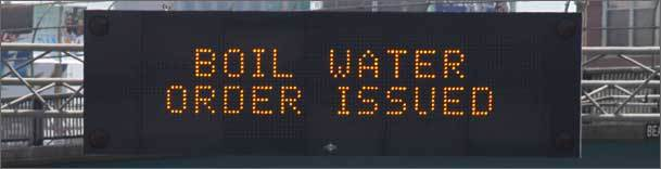 This sign on the Massachusetts Turnpike near the Prudential Center tunnel in Boston warns motorists about the pipe break that left 2 million Greater Boston residents without clean drinking water.