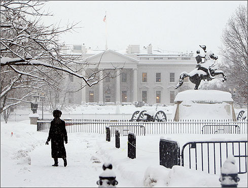 Angela Malone walked in Lafayette Park across from the White House as more snow fell on the already whitened Washington landscape.
