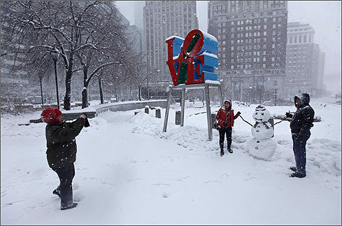 Winter weather revelers posed for a photograph at John F. Kennedy Plaza, also known as Love Park, in Philadelphia.