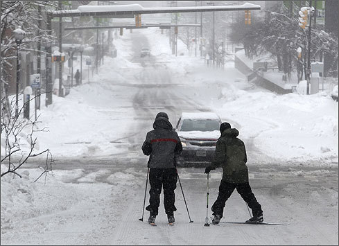 New England is battening down the hatches ahead of today's northeaster , late-coming it may be. Check out these scenes from the mid-Atlantic, where the storm has already dropped sheets of snow . A normally busy Baltimore street made for good skiing for this pair on Wednesday. Boston.com storm coverage: Where's the snow? Weather School, college, religious closings from WBZ-TV Blizzard hits Mid-Atlantic to New York Logan arrivals and departures from Massport Boston.com's Snow Plow Game