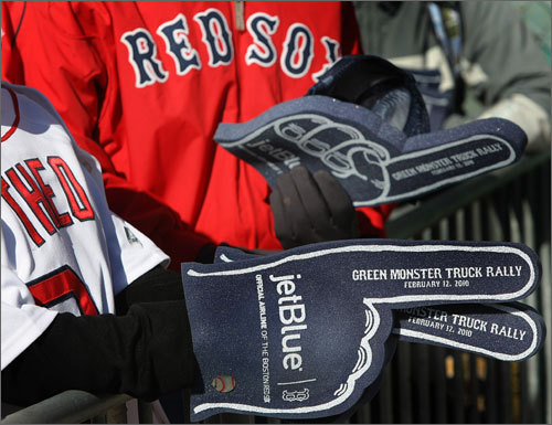 Fans were given free JetBlue foam fingers as they bared the cold conditions to watch the truck loaded.