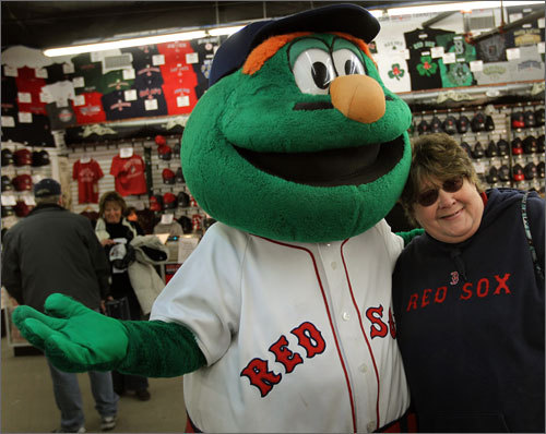 Wally took pictures with fans and gave them free Red Sox soft baseballs prior to departing for Florida.