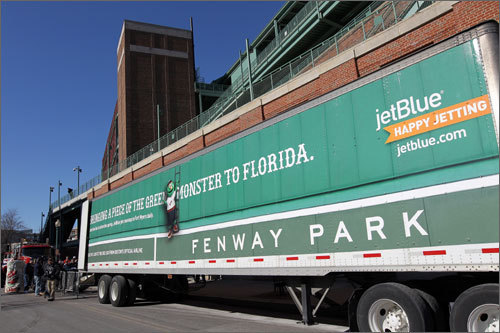 The truck that will haul the Red Sox equipment to the team's spring training facilities in Fort Myers, Fla., was parked, wrapped, and ready to load outside of Fenway Park on Friday morning. The banner wrapped around the truck reads, 'Bringing a piece of the Green Monster to Florida.'