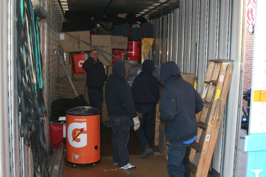 The moving crew gathered inside the trailer to plan their strategy. About seven movers were on hand from New England Household Moving and Storage, the Red Sox truck day partner for the past 12 years.