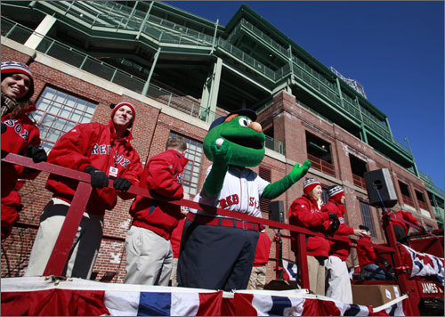 Red Sox ambassadors and Wally the Green Monster followed the procession out of Fenway on the back of a flat-bed truck. The ambassadors and Wally tossed soft Red Sox baseballs to fans looking on.