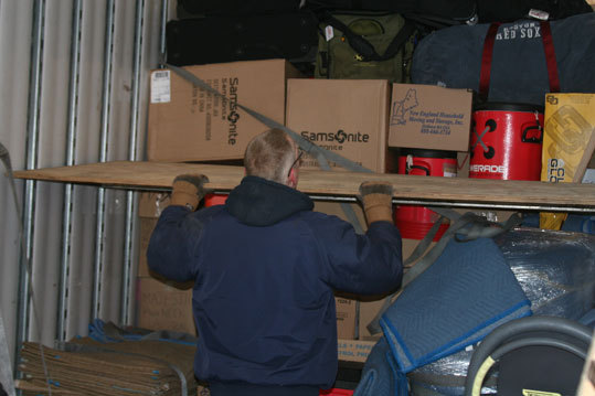 Hartz doesn't just drive the rig to Florida, he manages the loading process as well.