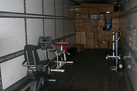 Some stationary cycles and weight training equipment were part of the packed items. The minor leaguers's gear gets loaded first. The major league equipment will be loaded at the end of the process.