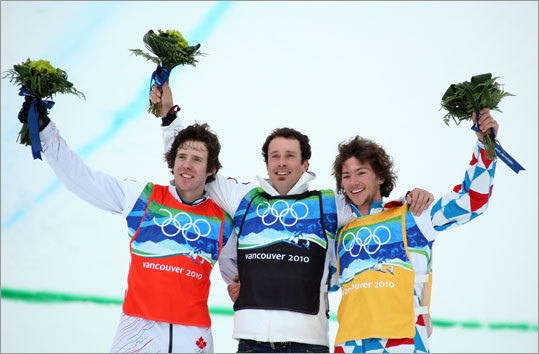 Seth Wescott (center) of Maine won Olympic gold in men's snowboardcross Monday at the Winter Olympics in Vancouver. Wescott, who owns a restaurant near Sugarloaf, Maine, also won Olympic gold at the Turin games in 2006. Mike Robertson (left) of Canada was second and Tony Ramoin of France was third.