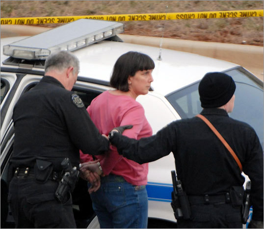 Bishop, seen here being taken into custody by Huntsville police, was also a suspect, along with her husband, in the attempted mail bombing of a Harvard Medical School professor in 1993.