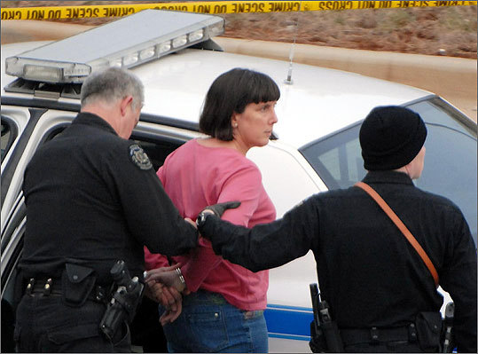 Amy Bishop is taken into custody by Huntsville, Ala. police on Friday, Feb. 12 in connection with fatal shootings on the University of Alabama at Huntsville campus.