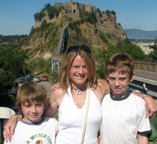 Karen Lynch and her sons Owen (left) and Henry on the road to Civita di Bagnoregio, Italy.